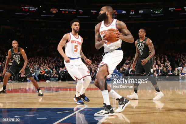 Kyle O'Quinn of the New York Knicks passes the ball during the game against the Milwaukee Bucks on February 6 2018 at Madison Square Garden in New...