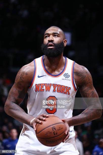 Kyle O'Quinn of the New York Knicks prepares for a free throw against the Brooklyn Nets on December 14 2017 at Barclays Center in Brooklyn New York...