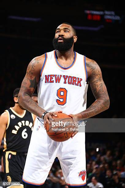 Kyle O'Quinn of the New York Knicks prepares to shoot a free throw against the Toronto Raptors on April 10 2016 at Madison Square Garden in New York...