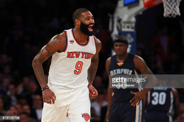 Kyle O'Quinn of the New York Knicks reacts against the Memphis Grizzlies during the first half at Madison Square Garden on October 29 2016 in New...