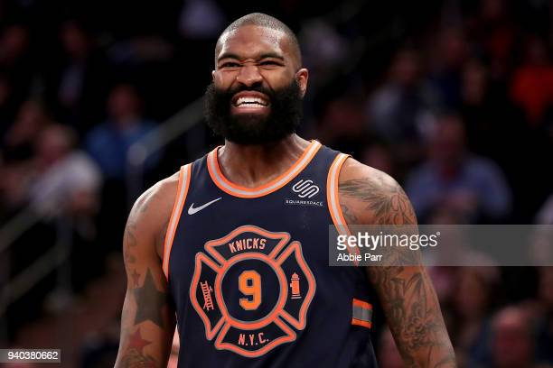 Kyle O'Quinn of the New York Knicks reacts in the third quarter against the Detroit Pistons during their game at Madison Square Garden on March 31...