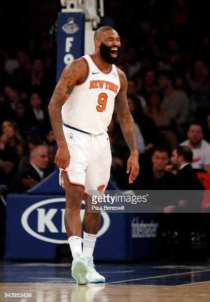 Kyle O'Quinn of the New York Knicks reacts laughing after he sunk a three point shot in an NBA basketball game against the Miami Heat on April 6 2018...
