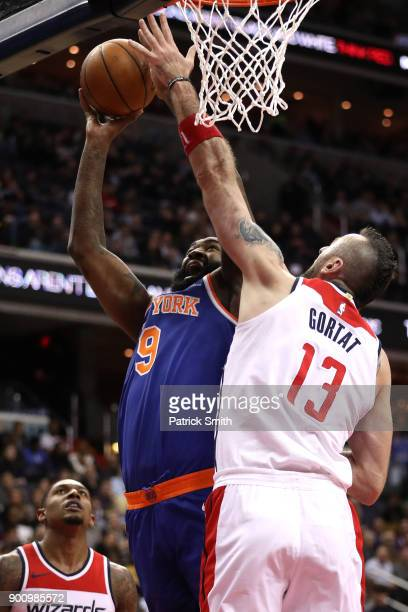 Kyle O'Quinn of the New York Knicks shoots in front of Marcin Gortat of the Washington Wizards during the first half at Capital One Arena on January...