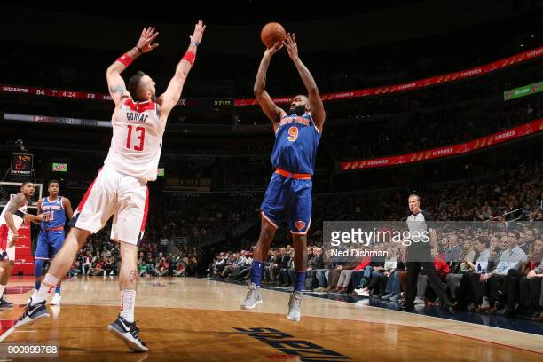 Kyle O'Quinn of the New York Knicks shoots the ball against Marcin Gortat of the Washington Wizards on January 3 2018 at Capital One Arena in...