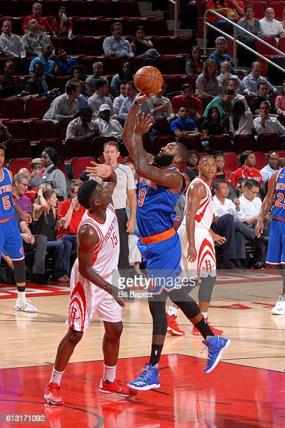 Kyle O'Quinn of the New York Knicks shoots the ball against the Houston Rockets during the preseason game on October 4 2016 at the Toyota Center in...