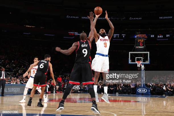 Kyle O'Quinn of the New York Knicks shoots the ball during a game against the Toronto Raptors on April 9 2017 at Madison Square Garden in New York...