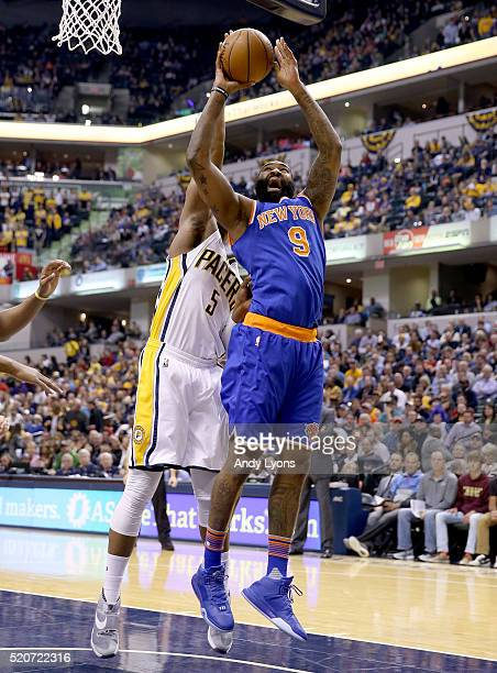 Kyle O'Quinn of the New York Knicks shoots the ball during the game against the Indiana Pacers at Bankers Life Fieldhouse on April 12 2016 in...