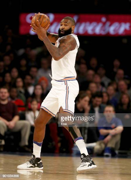 Kyle O'Quinn of the New York Knicks steals the ball in the first half against the San Antonio Spurs at Madison Square Garden on January 02 2018 in...