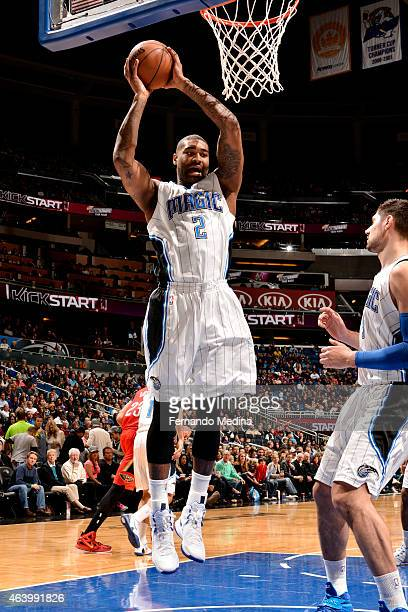 Kyle O'Quinn of the Orlando Magic grabs a rebound against the New Orleans Pelicans on February 20 2015 at Amway Center in Orlando Florida NOTE TO...