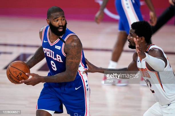 Kyle O'Quinn of the Philadelphia 76ers looks for help as Deandre Ayton of the Phoenix Suns defends during the first half of a NBA basketball game at...
