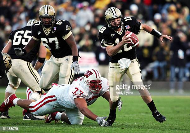 Kyle Orton of Purdue runs with the ball against Wisconsin during the game at RossAde Stadium on October 16 2004 in West Lafayette Indiana