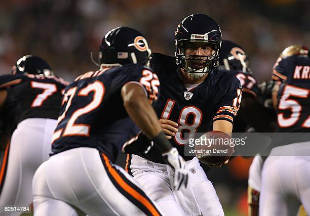 Kyle Orton of the Chicago Bears hands off to Matt Forte against the San Francisco 49ers on August 21 2008 at Soldier Field in Chicago Illinois The...
