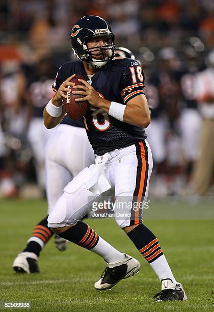 Kyle Orton of the Chicago Bears looks for a receiver against the San Francisco 49ers on August 21 2008 at Soldier Field in Chicago Illinois The 49ers...