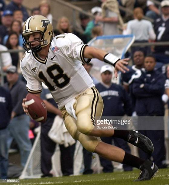 Kyle Orton tucks up the ball in the 2nd quarter of Purdue's 2013 win at Beaver Stadium State College PA October 9 2004