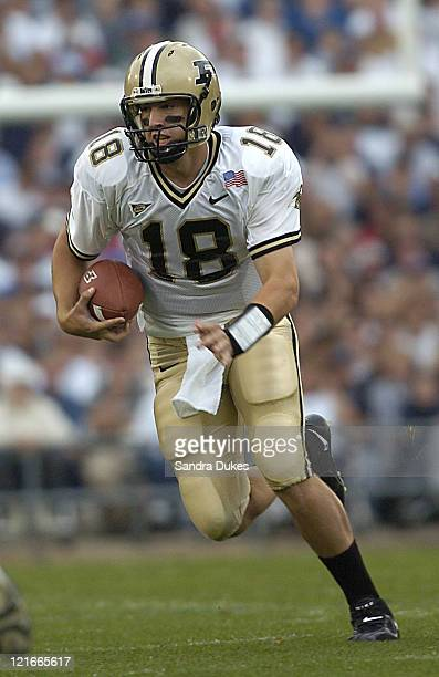 Kyle Orton tucks up the ball in the first quarter of Purdue's 2013 win at Beaver Stadium State College PA October 9 2004
