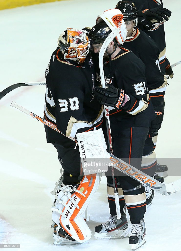 Kyle Palmieri #51 and goalie Viktor Fasth #30 of the Anaheim Ducks celebrate after the game against the Nashville Predators at Honda Center on February 27, 2013 in Anaheim, California. The Ducks won 5-1.