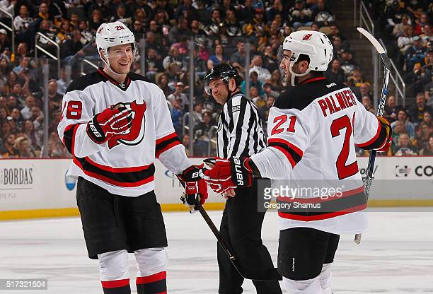 Kyle Palmieri celebrates his second goal of the game with Damon Severson of the New Jersey Devils during the first period against the Pittsburgh...