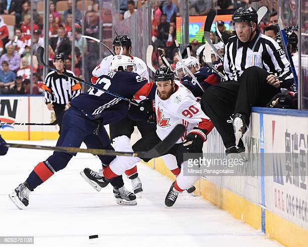 Kyle Palmieri of Team USA hits Ryan O'Reilly of Team Canada into the boards during the World Cup of Hockey 2016 at Air Canada Centre on September 20...