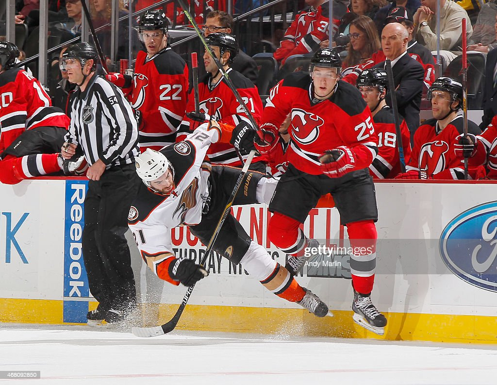 Kyle Palmieri #21 of the Anaheim Ducks and Stefan Matteau #25 of the New Jersey Devils come together during the game at the Prudential Center on March 29, 2015 in Newark, New Jersey.