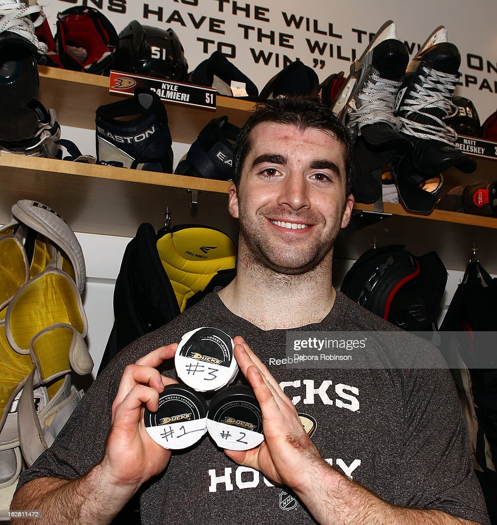 Kyle Palmieri #51 of the Anaheim Ducks holds up three pucks after the game against the Nashville Predators on February 27, 2013 at Honda Center in Anaheim, California. Palmieri recorded his first career hat trick in a 5-1 win over the Predators.
