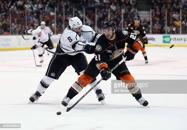 Kyle Palmieri of the Anaheim Ducks is checked by Drew Doughty of the Los Angeles Kings in the first period at Honda Center on December 3 2013 in...