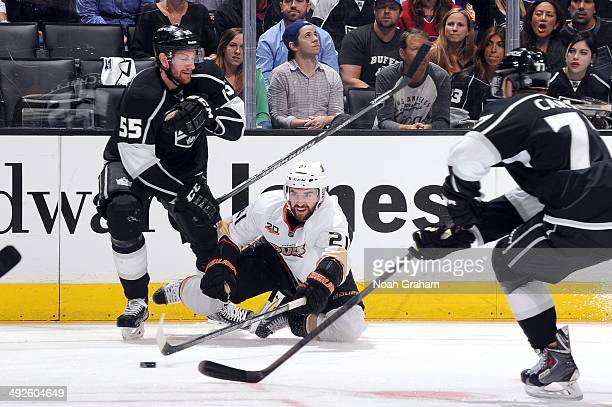 Kyle Palmieri of the Anaheim Ducks reaches for the puck against Jeff Schultz of the Los Angeles Kings in Game Six of the Second Round of the 2014...