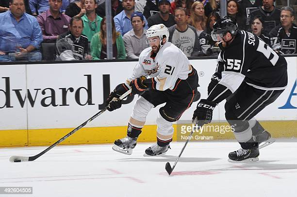 Kyle Palmieri of the Anaheim Ducks skates against Jeff Schultz of the Los Angeles Kings in Game Six of the Second Round of the 2014 Stanley Cup...