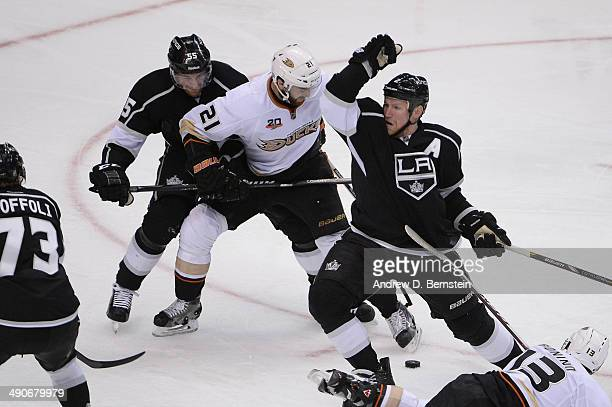 Kyle Palmieri of the Anaheim Ducks skates between Jeff Schultz and Matt Greene of the Los Angeles Kings in Game Six of the Second Round of the 2014...