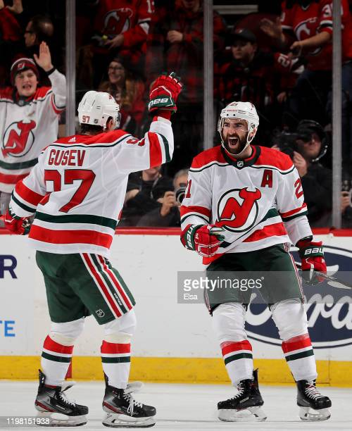Kyle Palmieri of the New Jersey Devils celebrates his goal with teammate Nikita Gusev in the third period against the New York Islanders at...