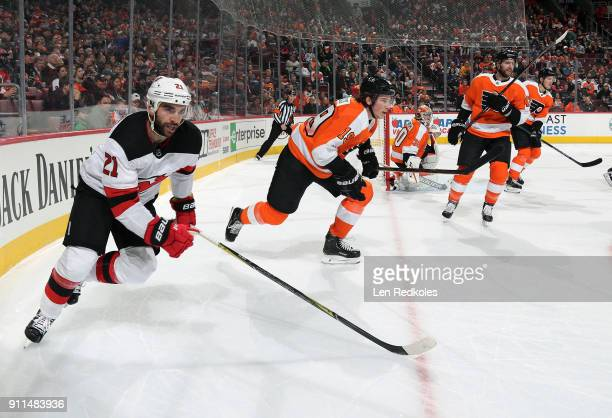 Kyle Palmieri of the New Jersey Devils in action against Nolan Patrick Andrew MacDonald Robert Hagg and Michal Neuvirth of the Philadelphia Flyers on...