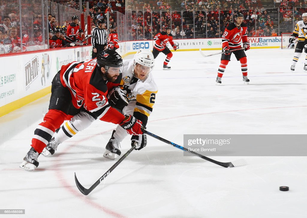Kyle Palmieri of the New Jersey Devils passes the puck past
