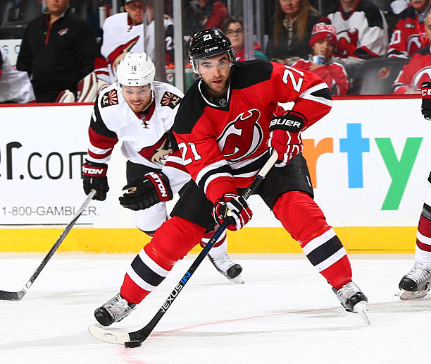 2bb00df3f NEWARK, NJ - OCTOBER 20: Kyle Palmieri #21 of the New Jersey Devils plays  the puck against the Arizona Coyotes during the game at the Prudential  Center on ...