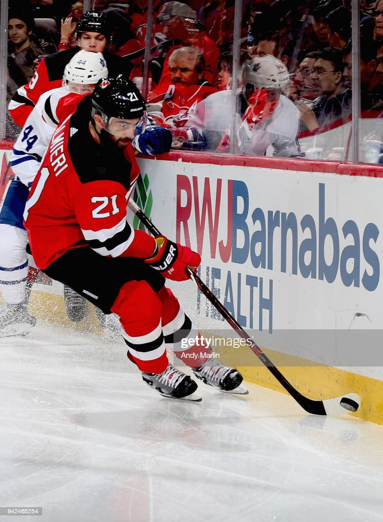 Kyle Palmieri #21 of the New Jersey Devils plays the puck against the Toronto Maple Leafs during the game at Prudential Center on April 5, 2018 in Newark, New Jersey.