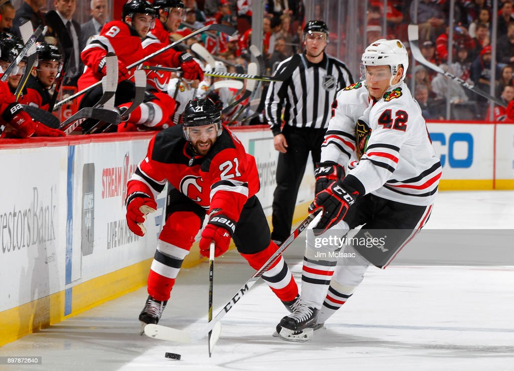 best sneakers 9a94c 3d585 Kyle Palmieri of the New Jersey Devils reaches for the puck ...