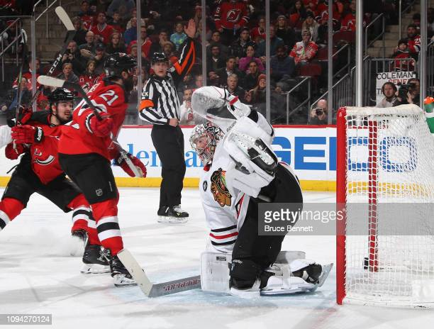 Kyle Palmieri of the New Jersey Devils scores at 516 of the second period against Cam Ward of the Chicago Blackhawks at the Prudential Center on...