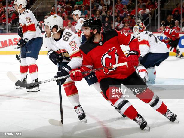 Kyle Palmieri of the New Jersey Devils skates against Mike Hoffman of the Florida Panthers during the third period on October 14 2019 at the...