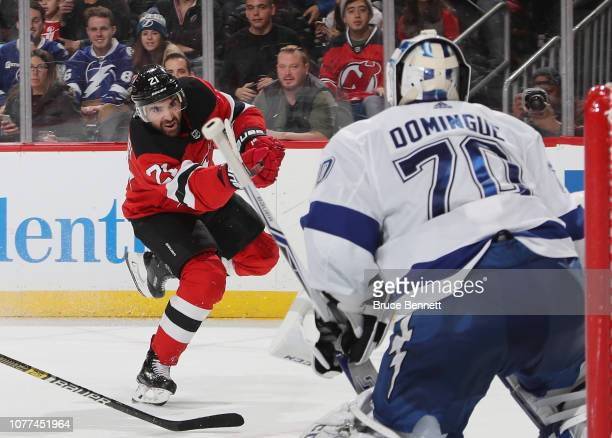 Kyle Palmieri of the New Jersey Devils skates against the Tampa Bay Lightning at the Prudential Center on December 03, 2018 in Newark, New Jersey....