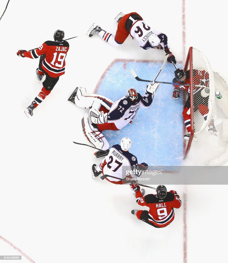 Kyle Palmieri #21 of the New Jersey Devils slides into the net past Sergei Bobrovsky #72 of the Columbus Blue Jackets during the first period at the Prudential Center on March 5, 2017 in Newark, New Jersey. The Blue Jackets shutout the Devils 3-0.