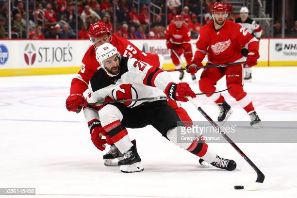 Kyle Palmieri of the New Jersey Devils tries to get around the stick of Niklas Kronwall of the Detroit Red Wings during the third period at Little...