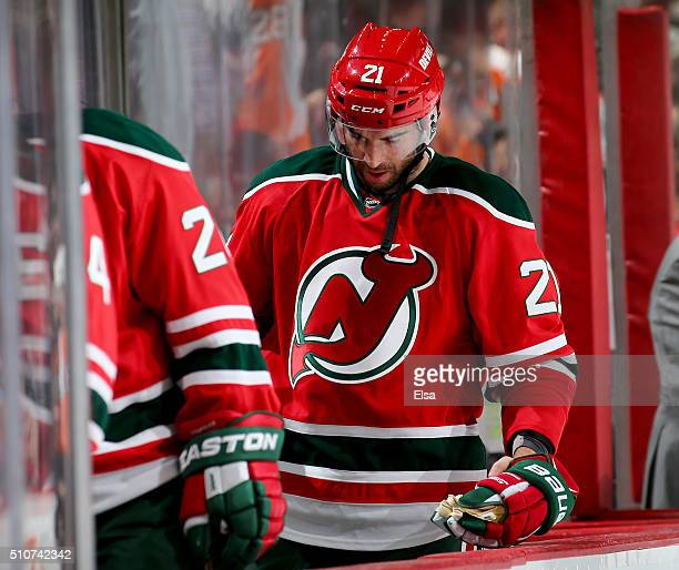 Kyle Palmieri of the New Jersey Devils walks off the bench after the loss to the Philadelphia Flyers on February 16 2016 at Prudential Center in...