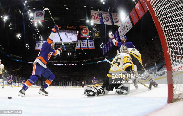 Kyle Palmieri of the New York Islanders celebrates his goal at 12:25 of the first period against Tristan Jarry of the Pittsburgh Penguins and is...