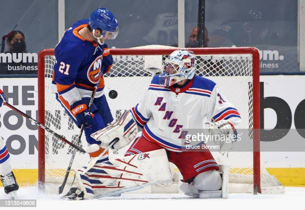 Kyle Palmieri of the New York Islanders is stopped by Igor Shesterkin of the New York Rangers during the first period at the Nassau Coliseum on April...