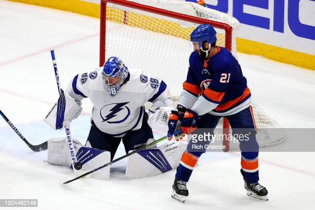 Kyle Palmieri of the New York Islanders plays the puck against Andrei Vasilevskiy of the Tampa Bay Lightning during the third period in Game Four of...