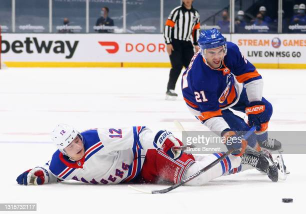 Kyle Palmieri of the New York Islanders takes a first period penalty for tripping Julien Gauthier of the New York Rangers at the Nassau Coliseum on...