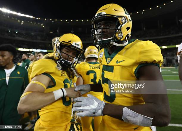 Kyle Peterson and Denzel Mims of the Baylor Bears celebrate a 2410 win against the Texas Longhorns at McLane Stadium on November 23 2019 in Waco Texas