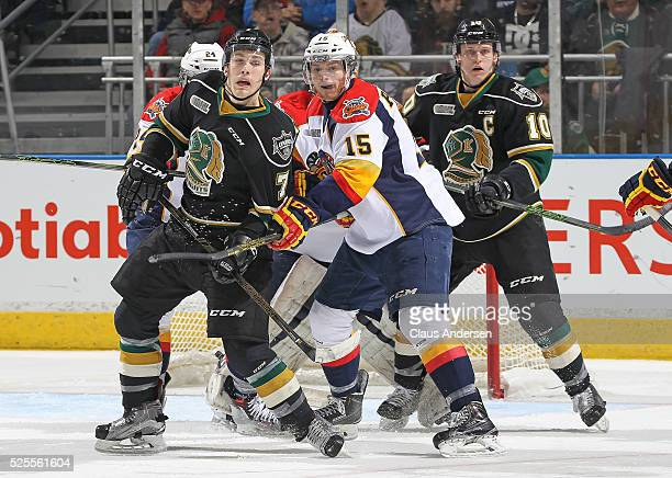 Kyle Petit of the Erie Otters battles between Matthew Tkachuk and Christian Dvorak of the London Knights during game four of the OHL Western...