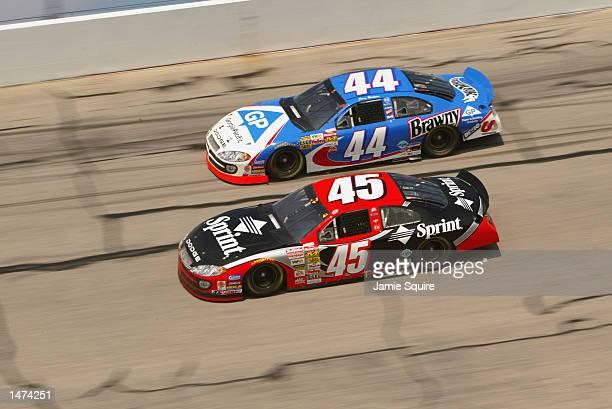 Kyle Petty driver of the Petty Enterprises Dodge Intrepid R/T races alongside teammate Jerry Nadeau driver of the Petty Enterprises Dodge Intrepid...