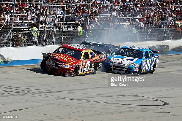 Kyle Petty driver of the Wells Fargo Dodge crashes with Denny Hamlin driver of the FedEx Ground Chevrolet and Clint Bowyer driver of the DIRECTV...