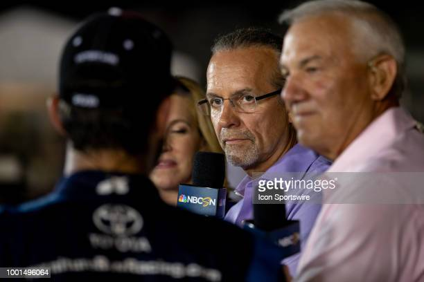 Kyle Petty NBCSN tv host listens to Martin Truex Jr driver of the AutoOwners Insurance Toyota on set after the Monster Energy NASCAR Cup Series...