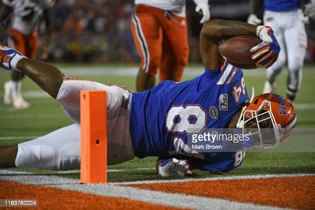 Kyle Pitts of the Florida Gators falls short of the goal line in the second half against the Miami Hurricanes in the Camping World Kickoff at Camping...